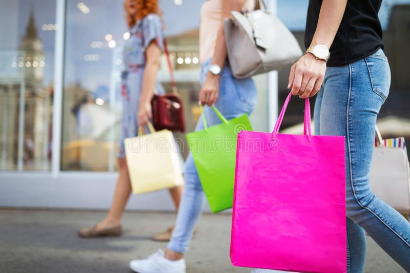 Sale and travel, happy people concept. Women with shopping bags in the ctiy royalty free stock photo