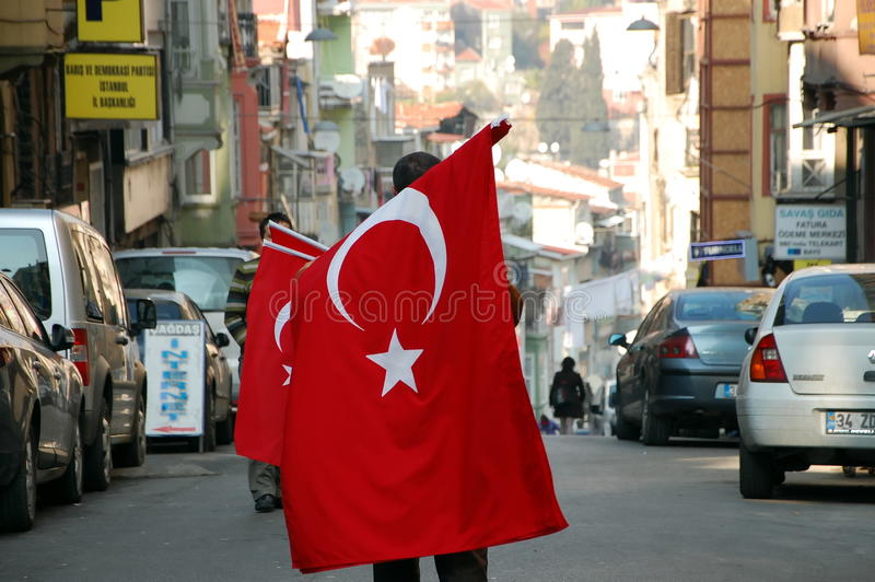 Sale of Turkish flags. ISTANBUL, TURKEY - NOV 22, 2011 - Man sells Turkish flags on the streets of Istanbul royalty free stock photography