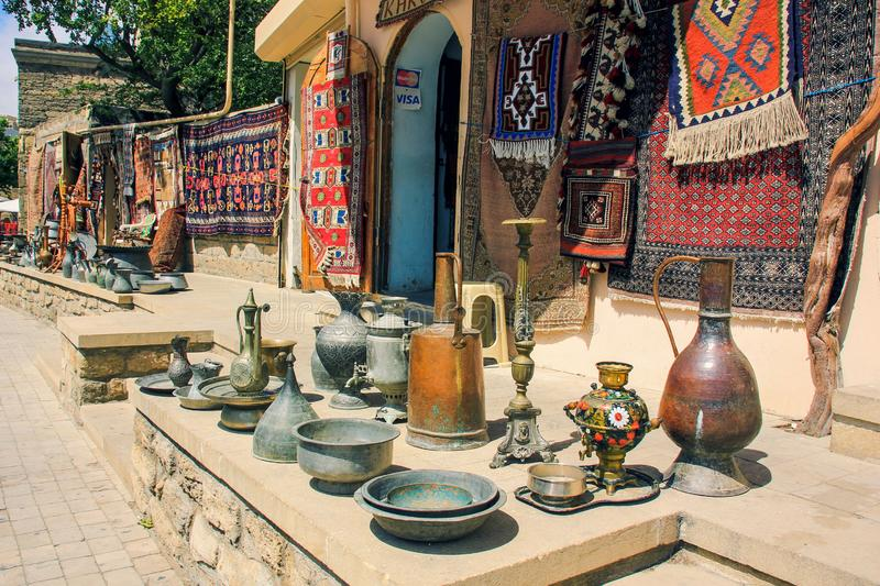 Sale of vintage traditional antiquarian items at the flea street market in  famous Old Town Baku, Azerbaijan stock photos