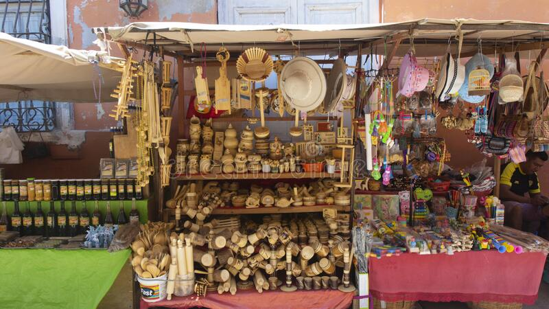 Sale of wooden crafts in a tourist street in the center of town royalty free stock image