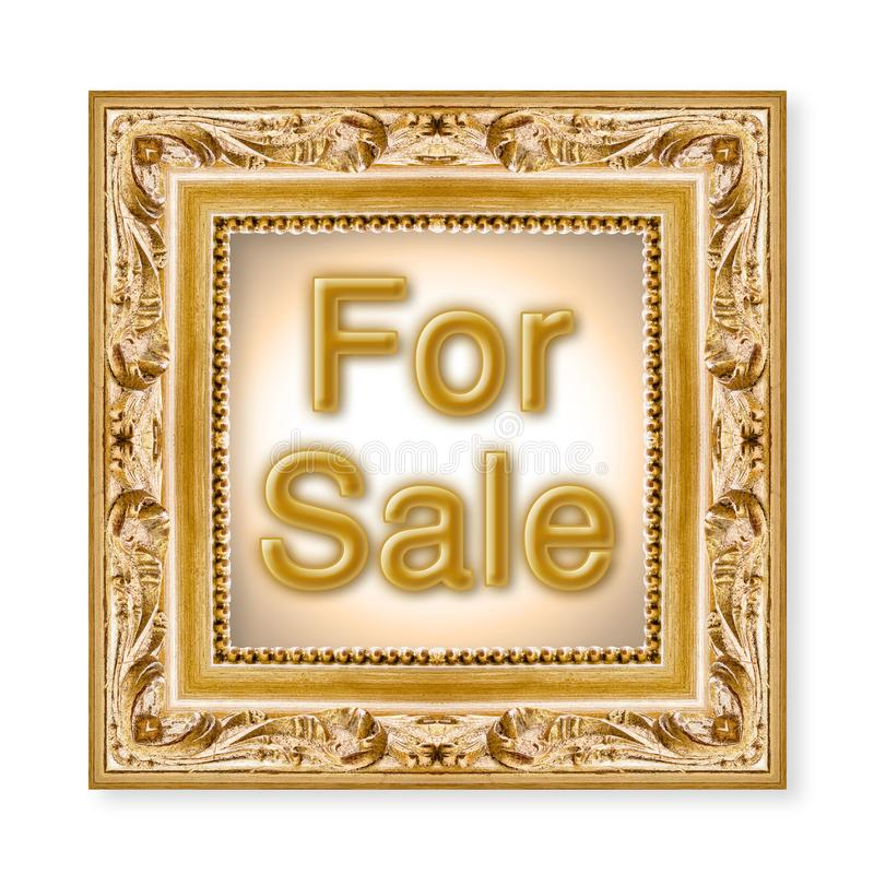 For sale written in a carved and golden wooden frame.  royalty free stock image