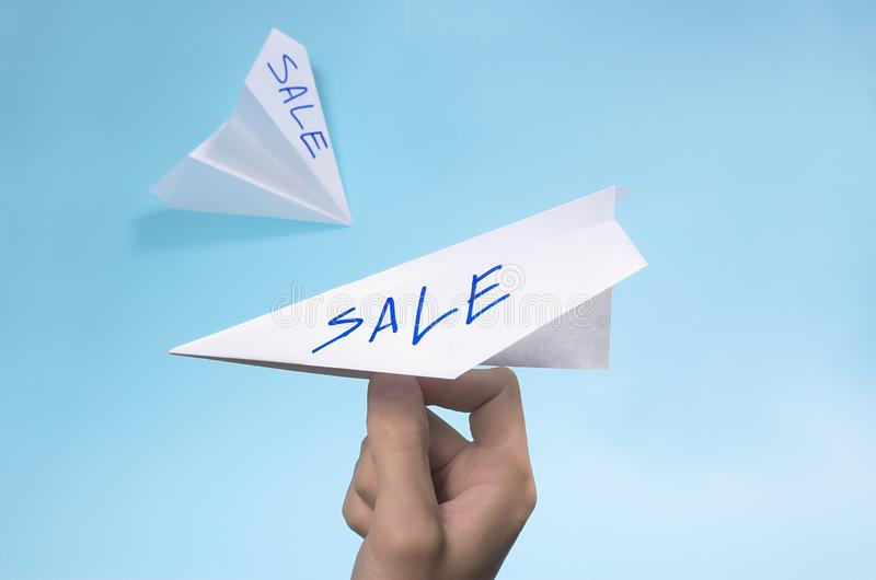 Sale written on a paper stock image