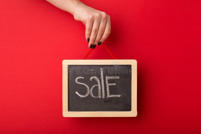 Sale written on school blackboard royalty free stock image
