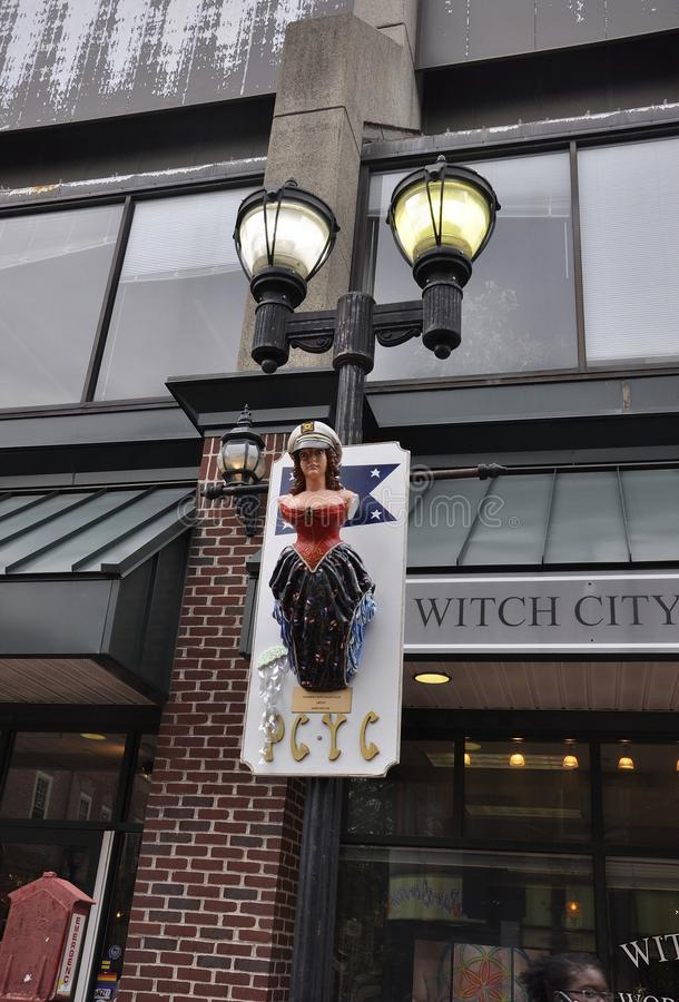 Salem, MA, 1st June: Witch hanging on pillar miniature from Salem in Essex county Massachusettes state of USA royalty free stock photo