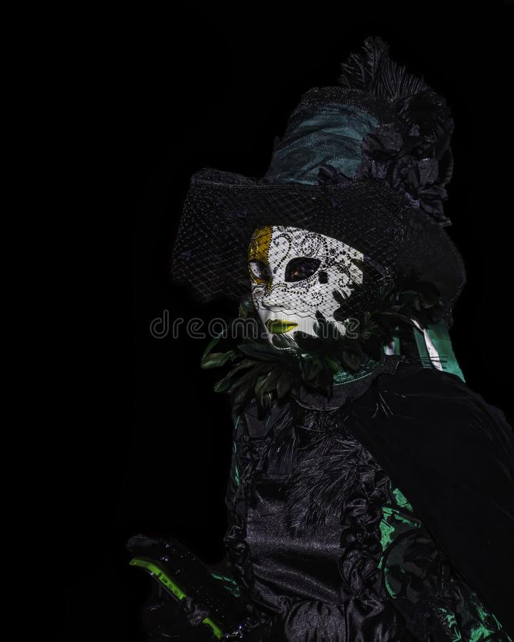 The masked woman on a dark halloween night in Salem Massachusetts royalty free stock images