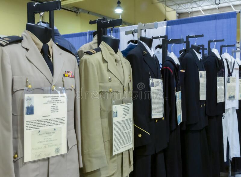 Isolated display of a row of vintage United States military uniforms. Salem, Oregon / USA - July 12, 2019: Isolated display of a row of vintage United States royalty free stock images
