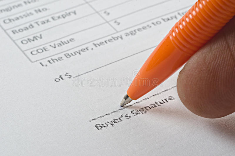 Sales agreement and pen stock photo
