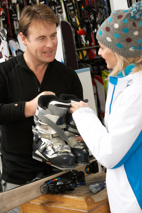 Download Sales Assistant Advising Customer On Ski Boots Stock Image - Image: 25646013