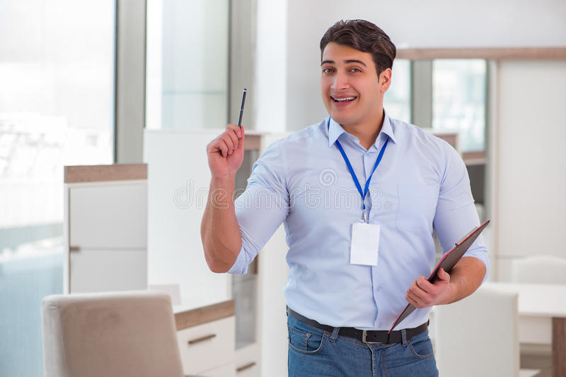 The sales assistant in furniture store stock photos