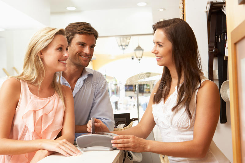 Sales Assistant In Store With Customers royalty free stock photo