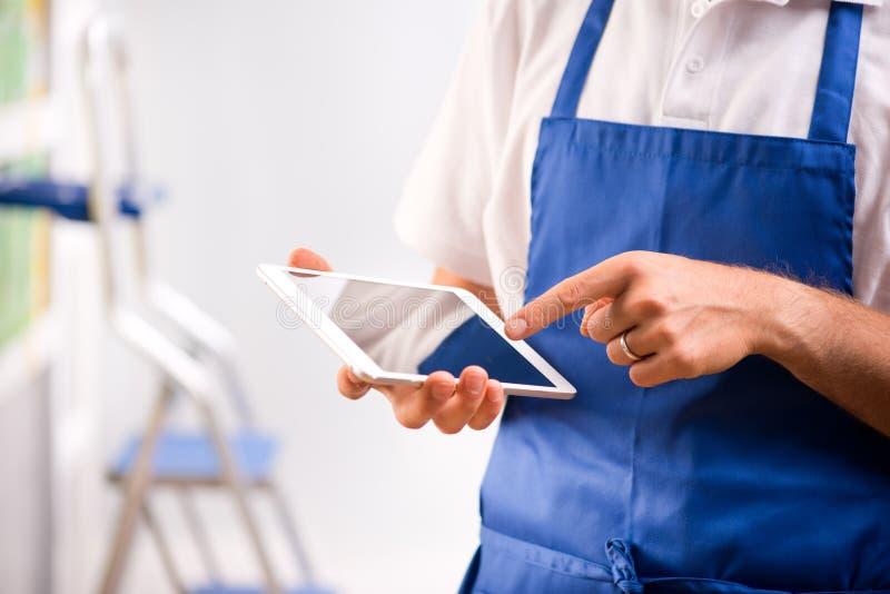 Sales clerk using tablet royalty free stock photo