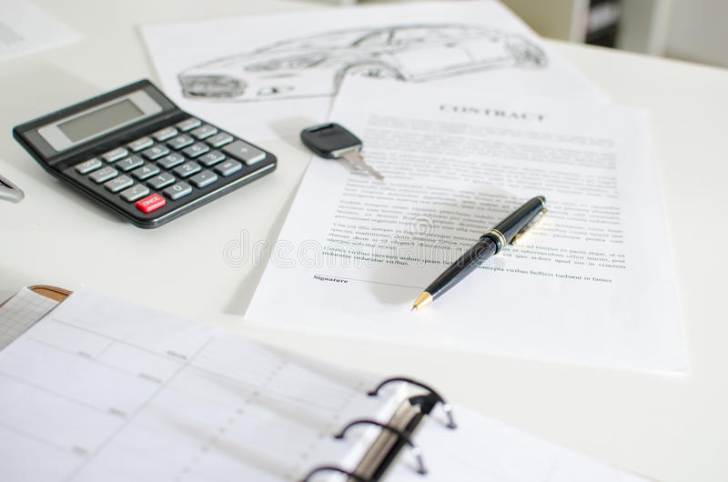 Sales contract, key, pen and calculator. On a desk stock photography
