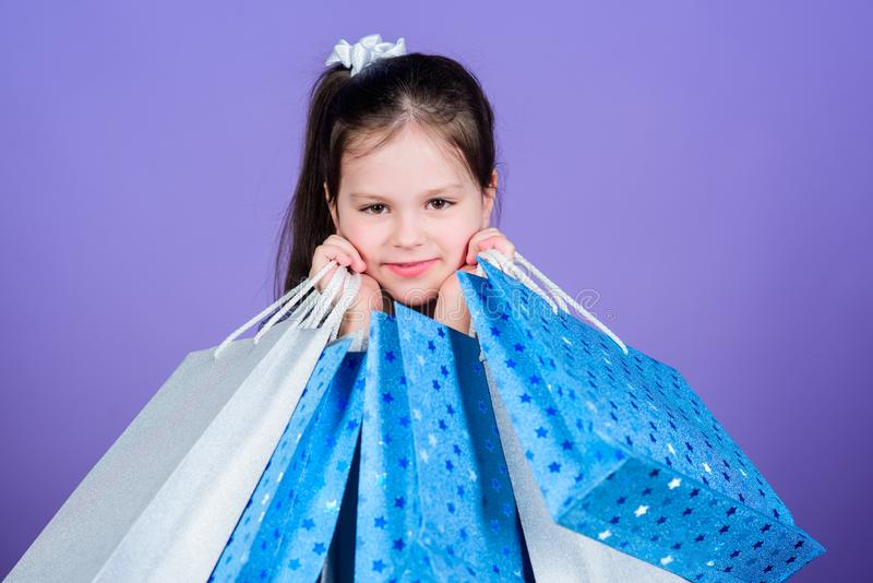 Sales and discounts. Kid fashion. shop assistant with pack. special offer. Holiday purchase saving. Small girl with. Shopping bags. Happy child. Little girl royalty free stock images