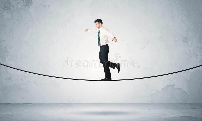 Sales guy balancing on tight rope stock images