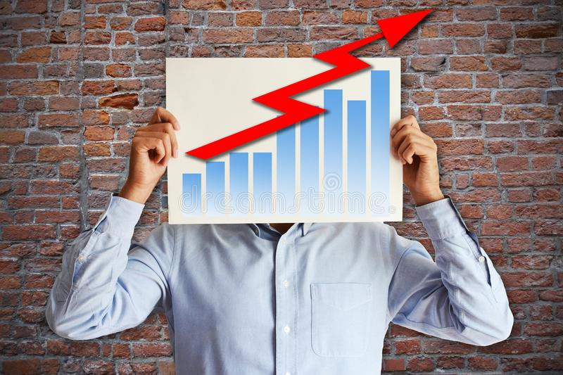 Sales increase strategy concept with businessman with chart and red ascending arrow on white board stock photos
