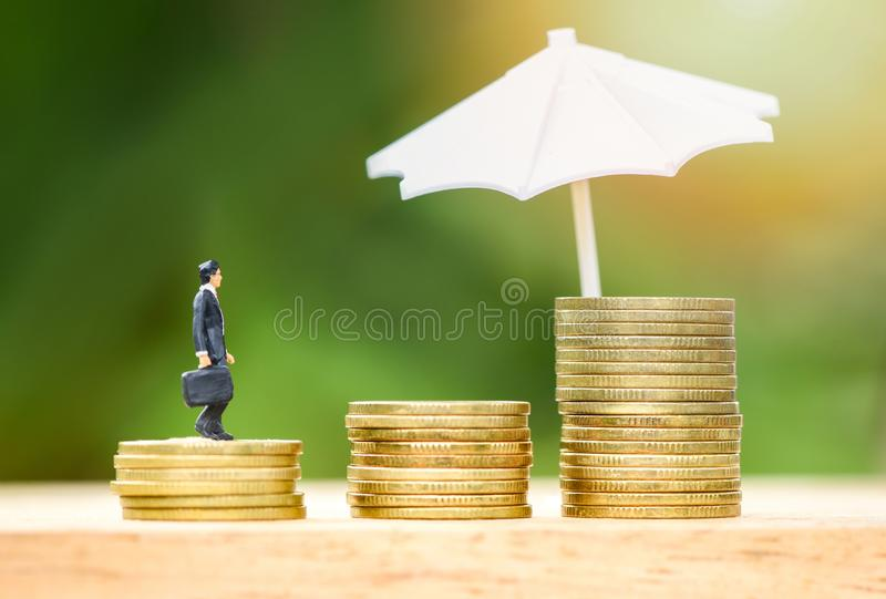 Sales insurance concept umbrella protecting gold coin step up growing stock images
