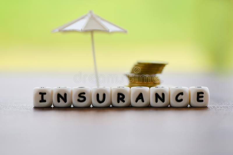 Sales insurance home , car, family concept / White umbrella protecting gold coin security of property insurance claim royalty free stock photography