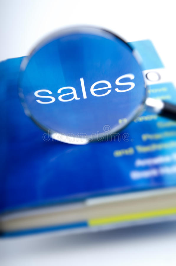 Sales Magnified. Sales word magnified from the front cover of a blue book royalty free stock photos