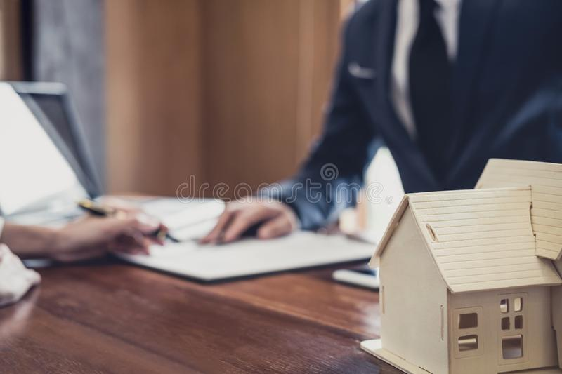 Sales manager filing keys to customer after signing rental lease contract of sale purchase agreement, concerning mortgage loan. Offer for and house insurance royalty free stock photography