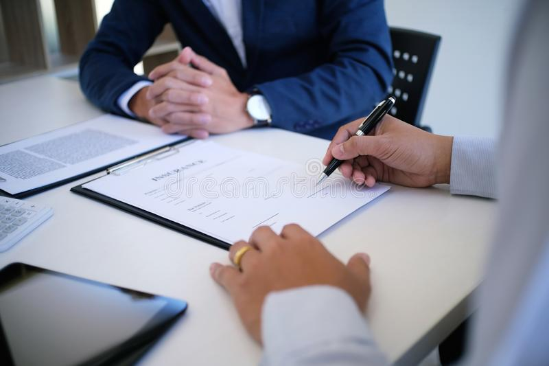 Sales manager giving advice application form document, considering mortgage loan offer for car and house insurance. royalty free stock images