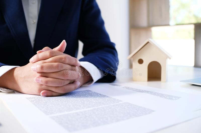 Sales manager giving advice application form document, considering mortgage loan offer for car and house insurance. stock photography