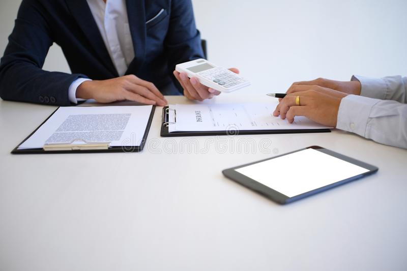 Sales manager giving advice application form document, considering mortgage loan offer for car and house insurance. royalty free stock photos