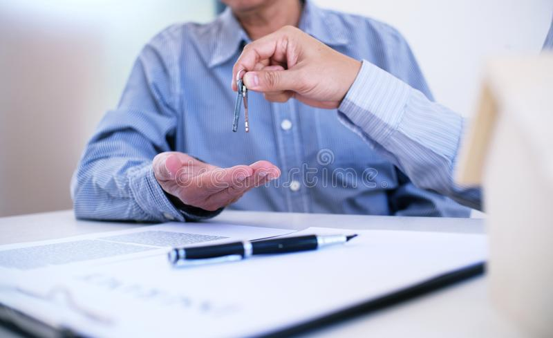 Sales manager giving advice application form document, considering mortgage loan offer for car and house insurance. Sales manager giving advice application form stock photography