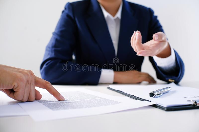 Sales manager giving advice application form document, considering mortgage loan offer for car and house insurance. Sales manager giving advice application form stock images