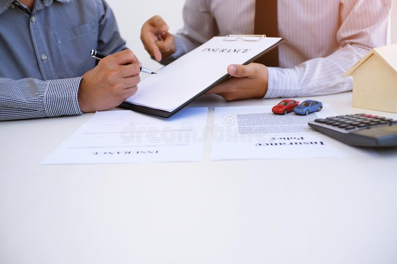 Sales manager giving advice application form document, consideri stock photography