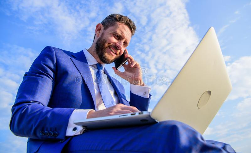 Sales manager responsibilities. Ultimate guide to becoming sales leader. Stay in touch. Man formal suit work with laptop. While speak on phone. Businessman royalty free stock photos