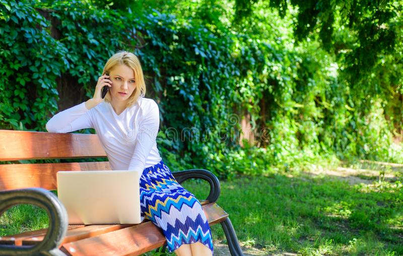 Sales manager works in park. Woman with laptop works outdoors. Best sales managers always possess these skills. Call stock image