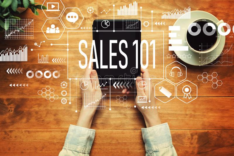 Sales 101 with a person holding a tablet stock images
