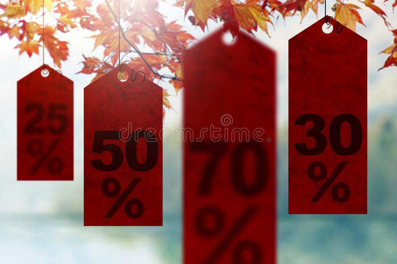 Sales Promotional in Fall Concept, Tags Hanging with Scence of M. Aple Autumn Leaves royalty free stock photography