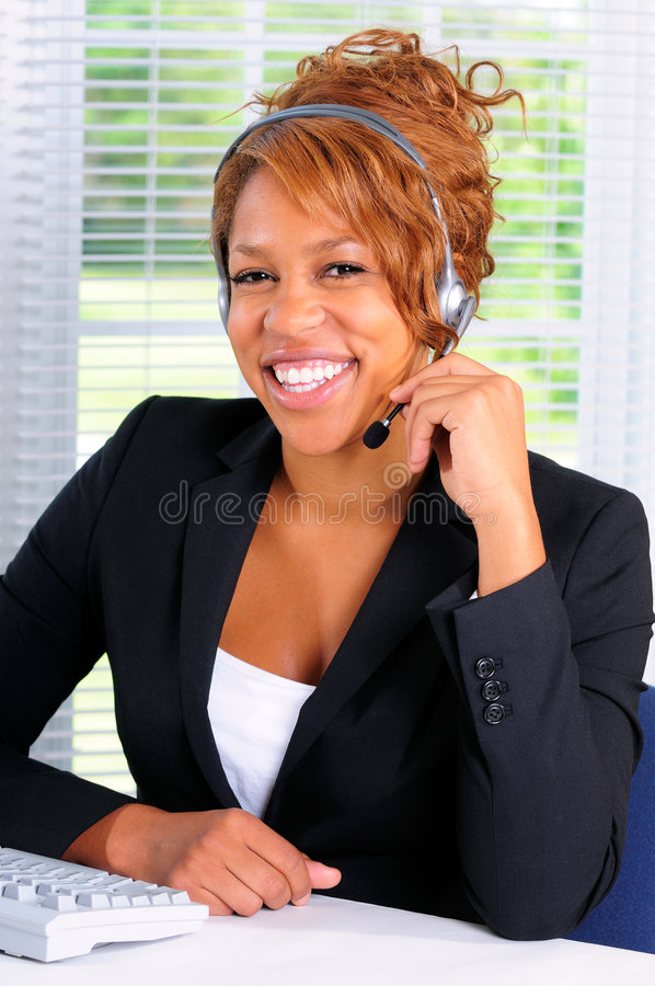 Sales Representative. Pretty Young Woman Using A Computer In A Call Cente Office royalty free stock photography