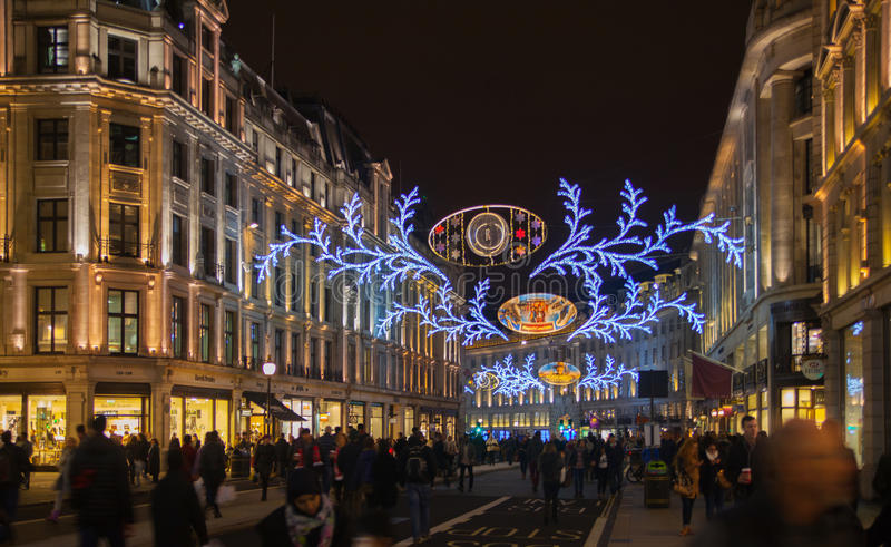 Sales started in London. Regent street in Christmas lights. LONDON, UK - NOVEMBER 30, 2014: Black Friday weekend in London the first sale before Christmas royalty free stock photography