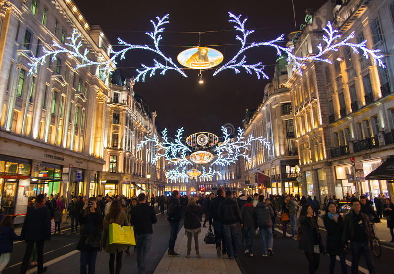 Sales started in London. Regent street in Christmas lights. LONDON, UK - NOVEMBER 30, 2014: Black Friday weekend in London the first sale before Christmas stock photo