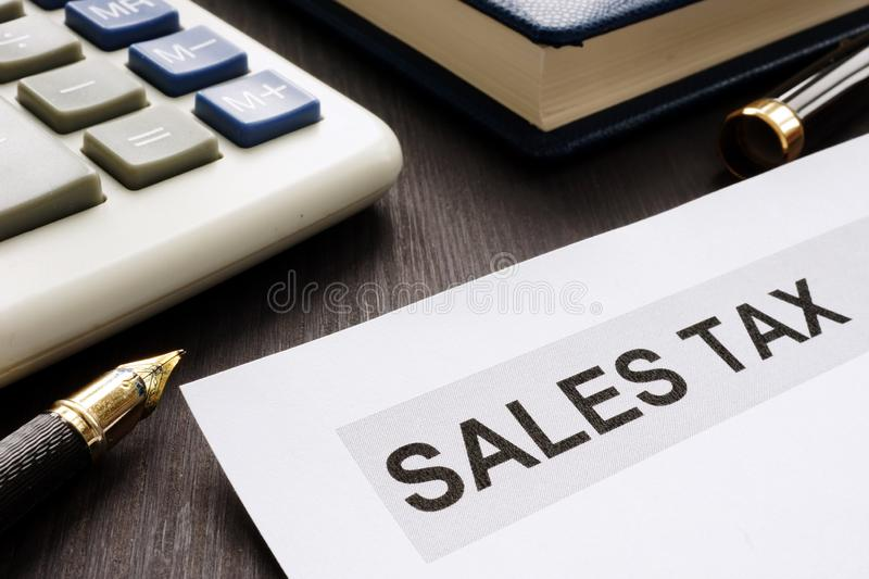 Sales tax. Papers on the office table. Sales tax concept. Papers on the office table royalty free stock photo