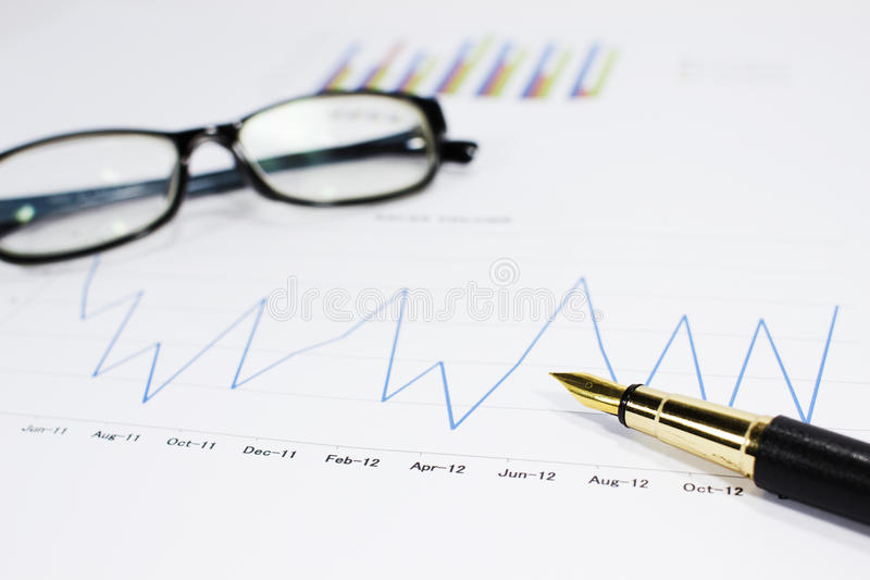 Download Sales Volume Charts On The Table With  Pen Stock Photo - Image: 26836952