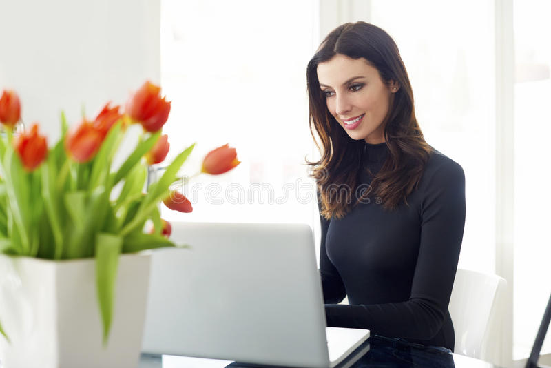 Sales woman with laptop royalty free stock image
