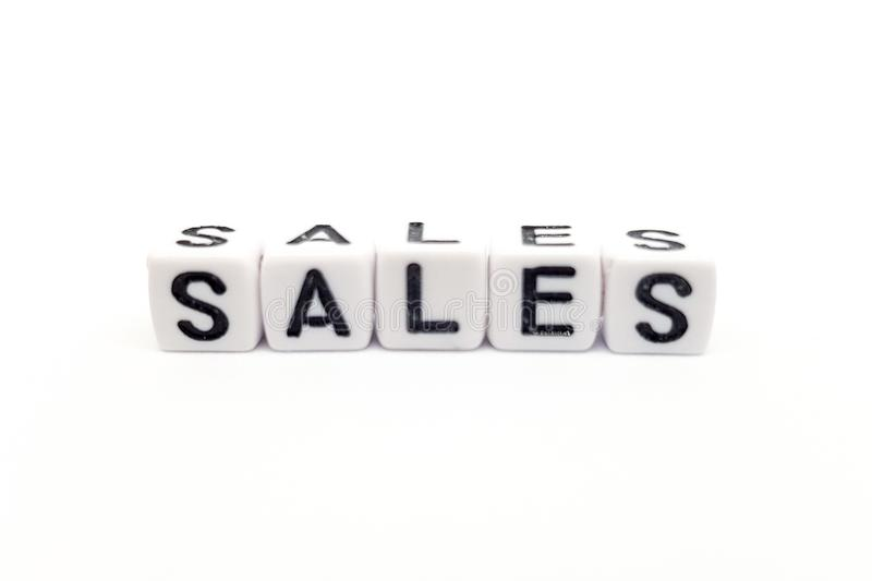 sales word built with white cubes and black letters on white background stock photo
