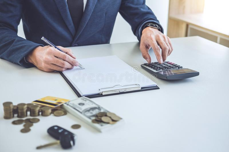 Salesman analyzing cost of buying new car and insurance document. Writing signature on contract to selling to customer royalty free stock image