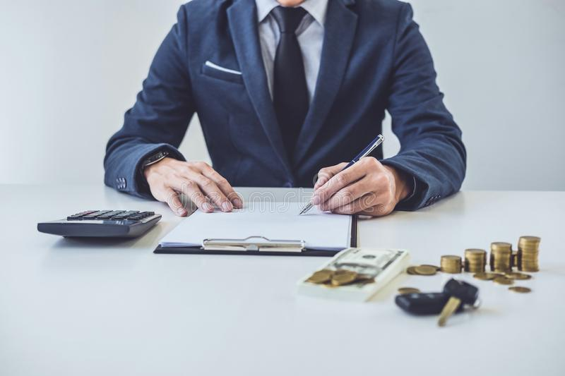 Salesman analyzing cost of buying new car and insurance document. Writing signature on contract to selling to customer royalty free stock photography