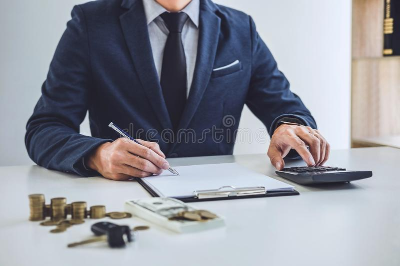 Salesman analyzing cost of buying new car and insurance document, Writing signature on contract to selling to customer.  stock image