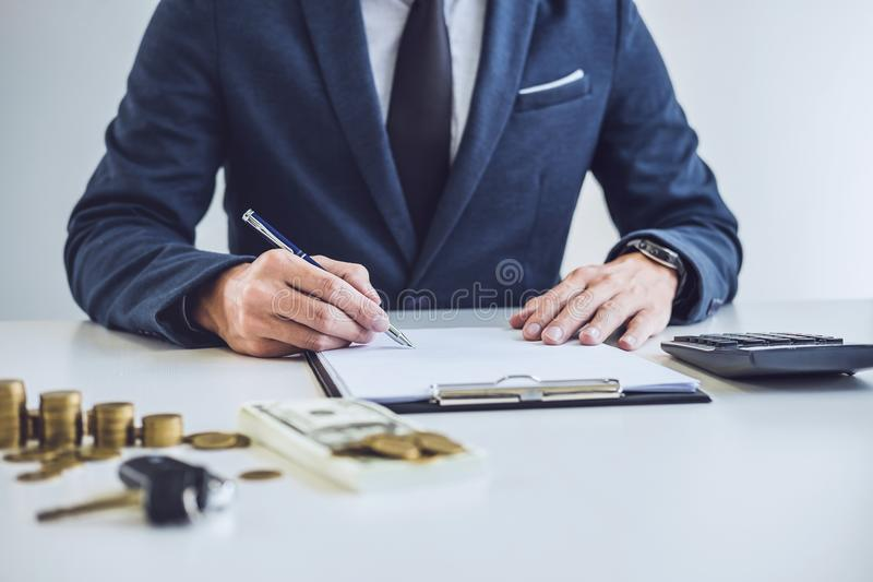 Salesman analyzing cost of buying new car and insurance document. Writing signature on contract to selling to customer royalty free stock photos