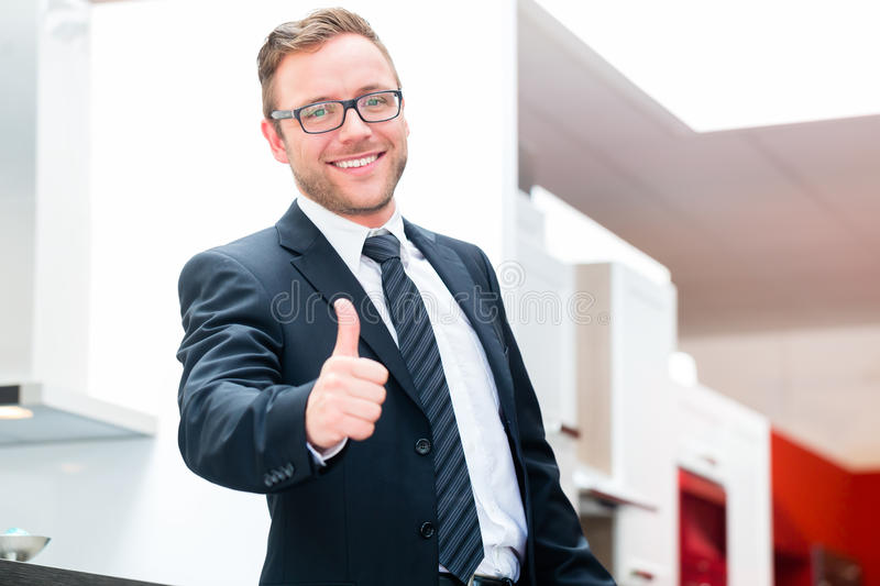 Salesman for domestic kitchen furniture store. Salesman for domestic kitchen in studio or furniture store stock photos
