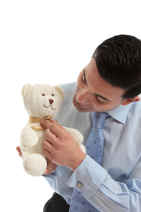 Salesman holding a teddy bear royalty free stock images