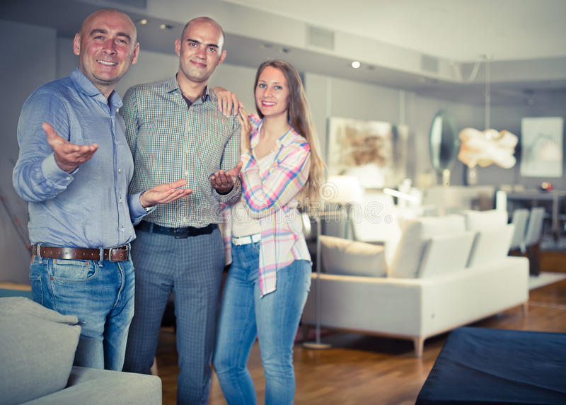 Salesman offering furniture to family couple royalty free stock photo