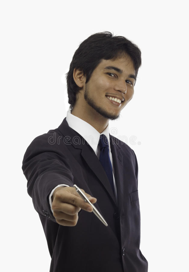 Salesman offering a pen. Asian salesman offering a pen for signing an agreement royalty free stock photo