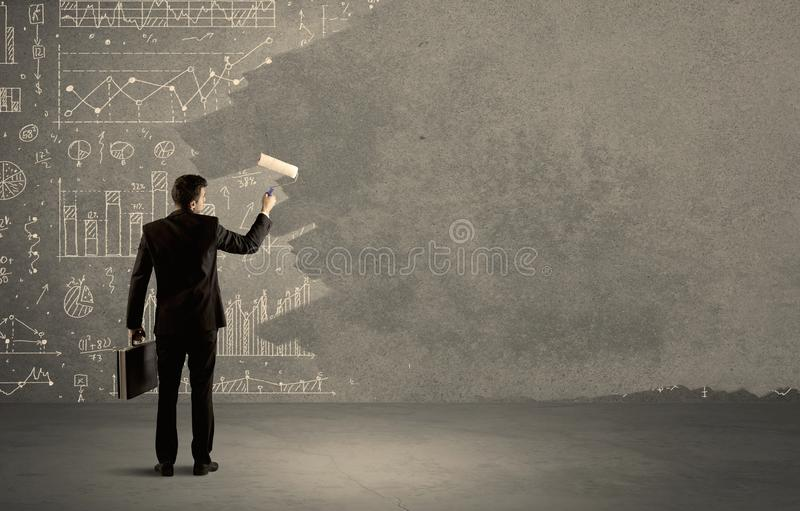 Salesman painting over charts on wall royalty free stock photos