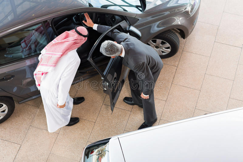 Salesman selling car royalty free stock photo